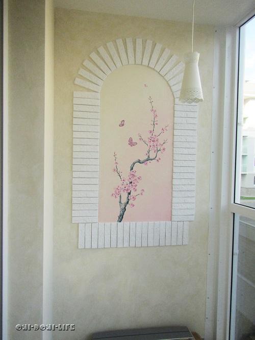 ветка сакуры на стене